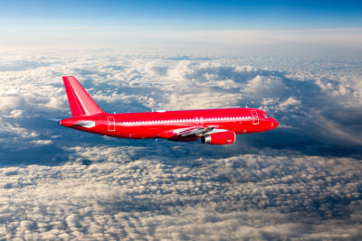 Red plane clouds jet group travel